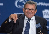 Joe Paterno flicking off reporters